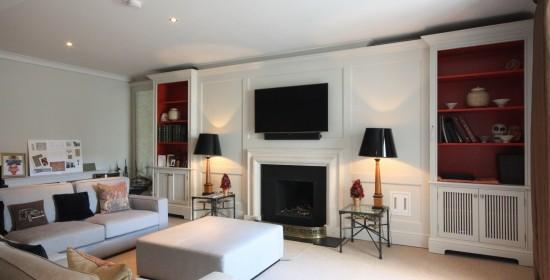 Bespoke wall panelling bookcases mirror TV unit enigma design