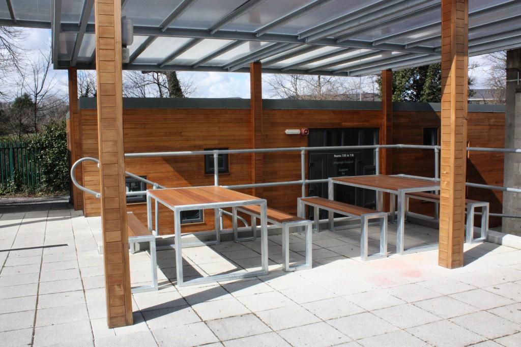Teak seating with galvanised steel frames