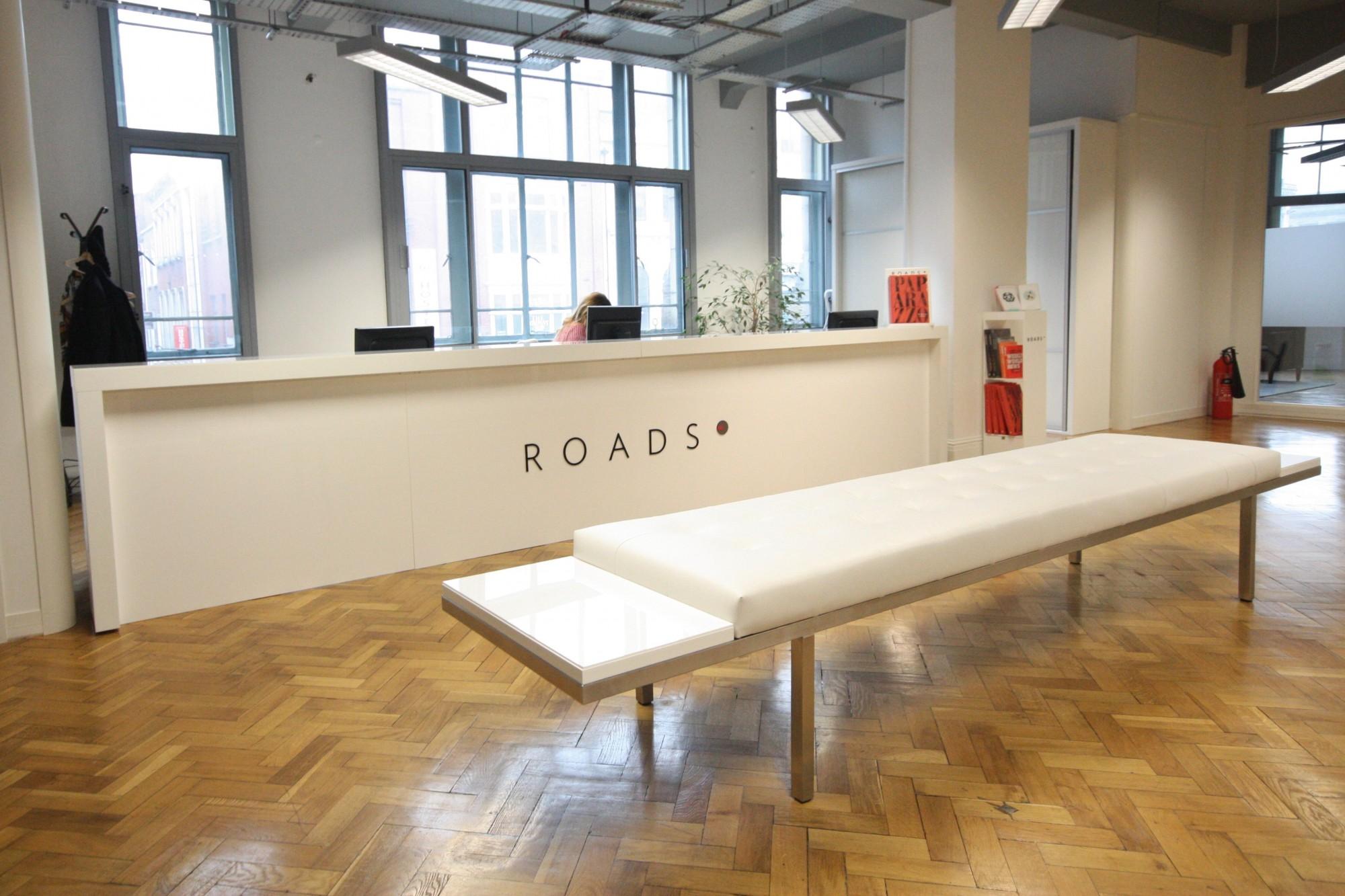 Reception desk with acryllic signage enigma bespoke cabinetry